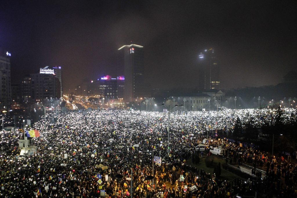 Protesters use phones and flashlights during a protest in Victoriei Square, in Bucharest, Romania, February 5, 2017. Inquam Photos/Adriana Neagoe/via REUTERS ATTENTION EDITORS - THIS IMAGE WAS PROVIDED BY A THIRD PARTY. EDITORIAL USE ONLY. ROMANIA OUT. NO COMMERCIAL OR EDITORIAL SALES IN ROMANIA. ROMANIA OUT. NO COMMERCIAL OR EDITORIAL SALES IN ROMANIA. - RTX2ZQ82