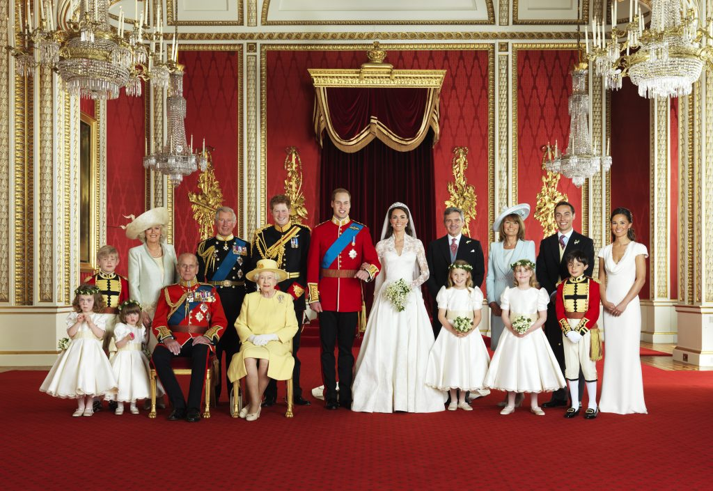 Britain's Prince William and his bride Catherine, Duchess of Cambridge (C), pose for an official photograph with their families on the day of their wedding, April 29, 2011, in the throne room at Buckingham Palace in central London. Photo by REUTERS/Hugo Burnand/Clarence House/Handout.