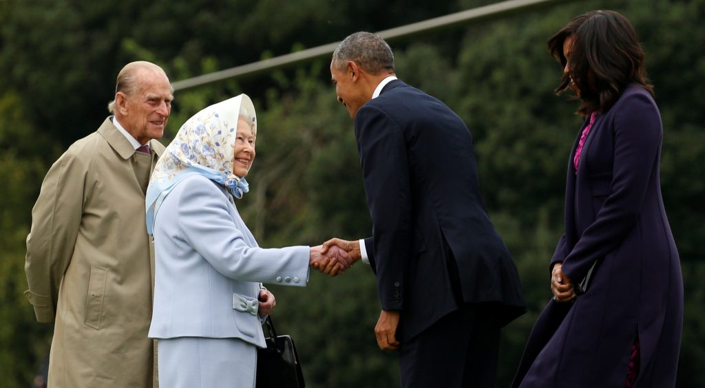 President Barack Obama and first lady Michelle Obama are greeted by Queen Elizabeth II and Prince Philip, Duke of Edinburgh upon their arrival for lunch in 2016 at Windsor Castle in Windsor, Britain. Photo by REUTERS/Kevin Lamarque.