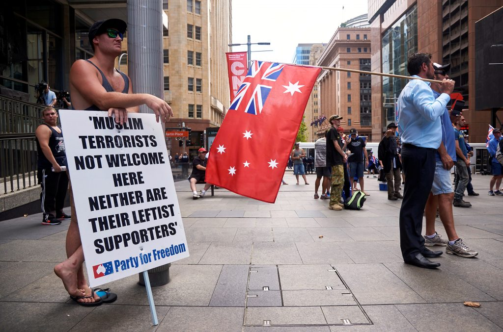 People hold placards and Australian national flags Jan. 29 as they attend a rally organised by the right-wing group called Reclaim Australia in central Sydney, Australia,  Photo by REUTERS/Aaron Bunch     .