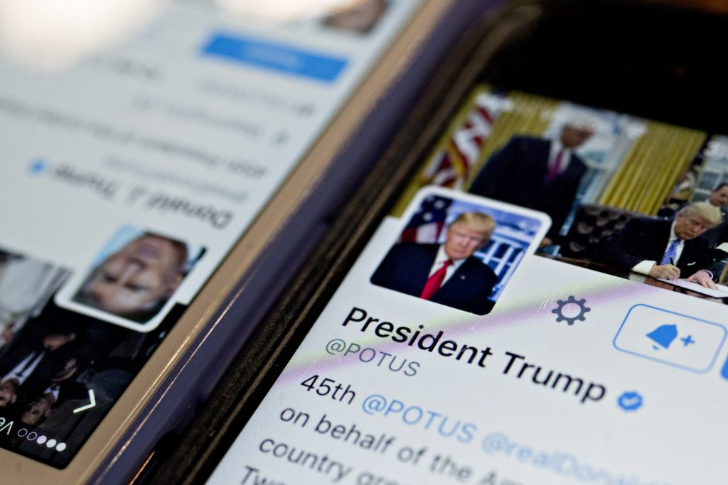 The verified Twitter account of President Donald Trump, @POTUS, is seen on a cell phone. Photo by Andrew Harrer/Bloomberg via Getty Images