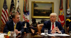 """Director of the Office of Management and Budget Mick Mulvaney (L) listens to U.S. President Donald Trump speak during a """"strategic initiatives"""" lunch Feb. 22 at the White House in Washington, D.C. Photo by REUTERS/Kevin Lamarque."""