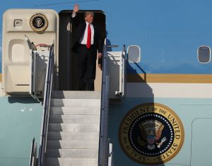 President Donald Trump waves Feb. 3 as he arrives on Air Force One at the Palm Beach International Airport for a visit to his Mar-a-Lago Resort. Trump will visit the resort again this weekend after his campaign rally at an airport hangar in Melbourne, Florida. Photo by Joe Raedle/Getty Images.