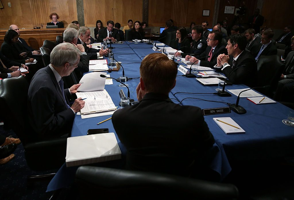 A group of security experts testify during a 2015 hearing before the Senate Homeland Security and Governmental Affairs Committee. The meeting was called  to explore how to strengthen the visa waiver program after the Paris attacks. Photo by Alex Wong/Getty Images.