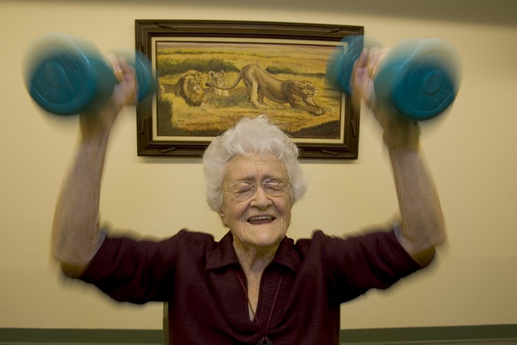 """100-year-old Marge Jetton lifts weights every morning.  """"I'm for anything that has to do with health"""" Jetton says.  Photo by Getty."""