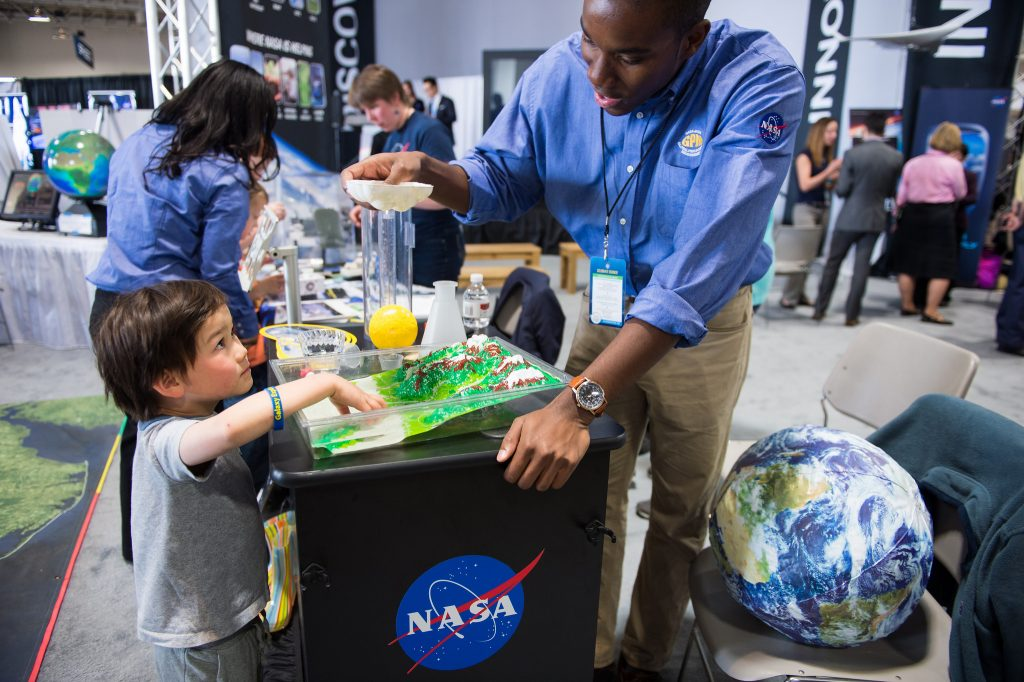 A NASA staff member describes the Global Precipitation Measurement Mission at the 2014 USA Science and Engineering Festival in Washington D.C. Photo by NASA/Aubrey Gemignani