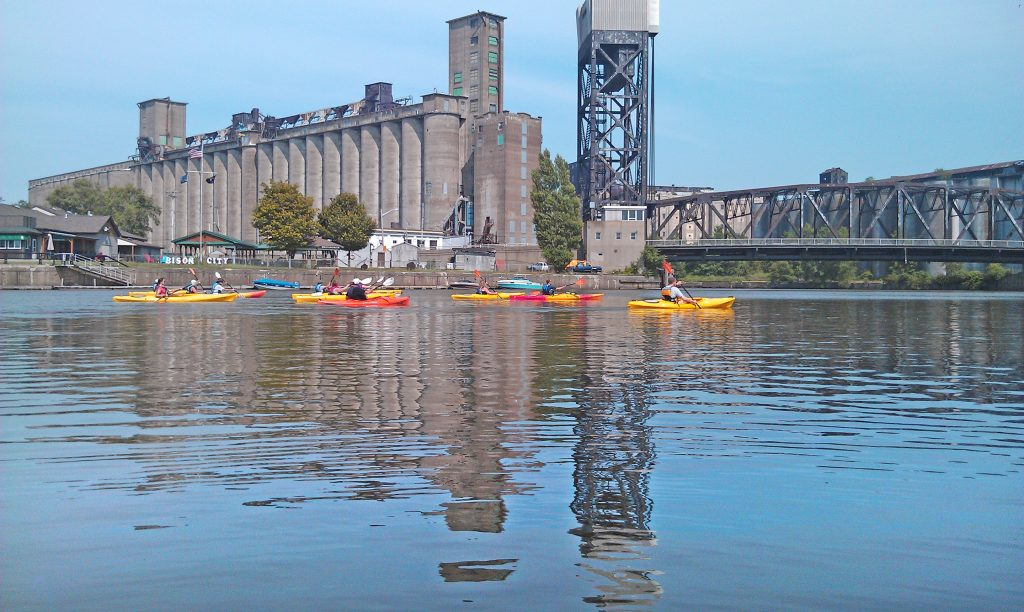Kayakers ifloat down the Buffalo River near Lake Erie, one of 3,400 projects funded by the Great Lakes Restoration Initiative since 2010. Photo courtesy of Buffalo Niagara Riverkeeper.