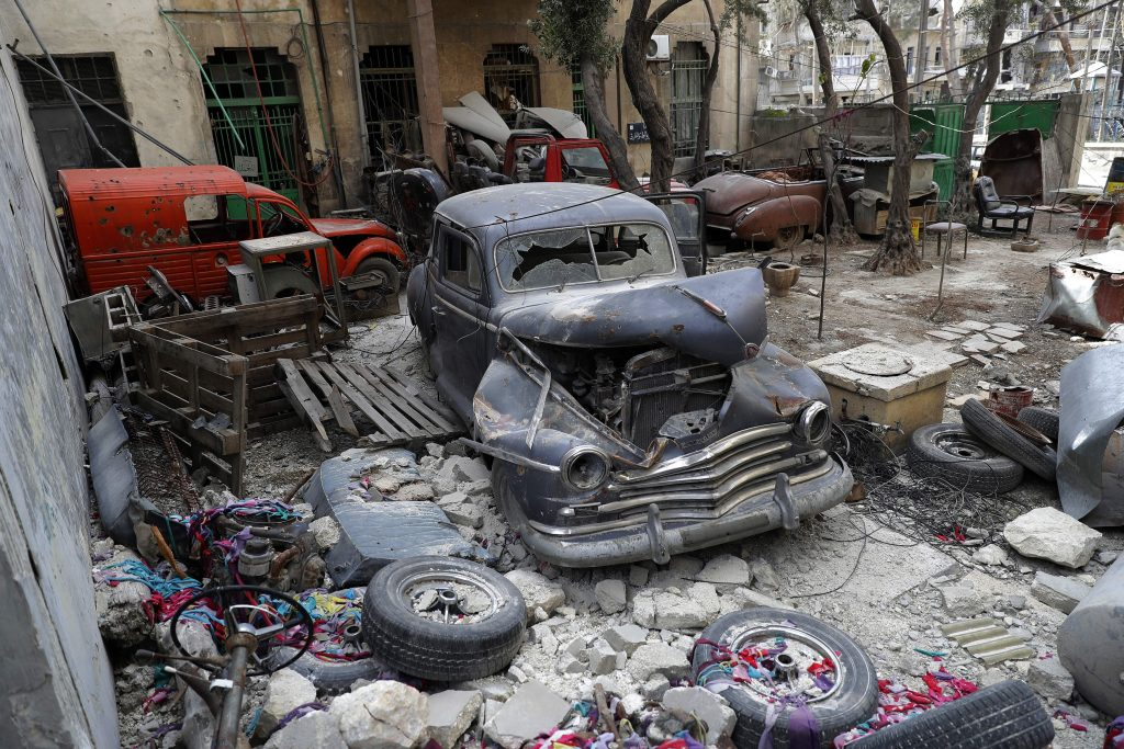 A 1947 Plymouth is parked in Mohammed Mohiedin Anis' garden, which holds other spare parts for his collection of cars. Photo by Joseph Eid/AFP/Getty Images