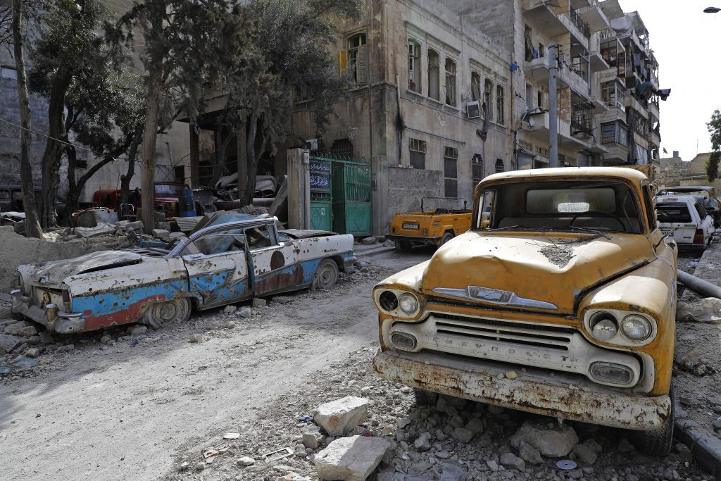 A 1958 Chevrolet Apache truck is parked in rubble from the fighting in Aleppo, Syria. Photo by Joseph Eid/AFP/Getty Images
