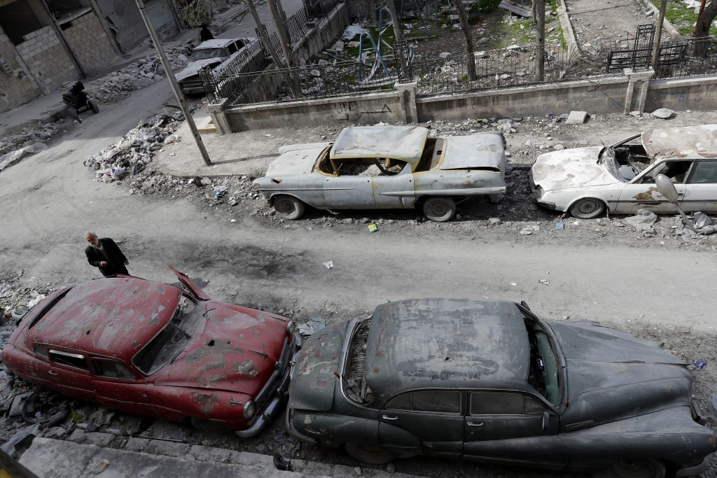 An overhead view shows the bombed-out neighborhood in Aleppo where car enthusiast Mohammed Mohiedin Anis still lives. Photo by Joseph Eid/AFP/Getty Images