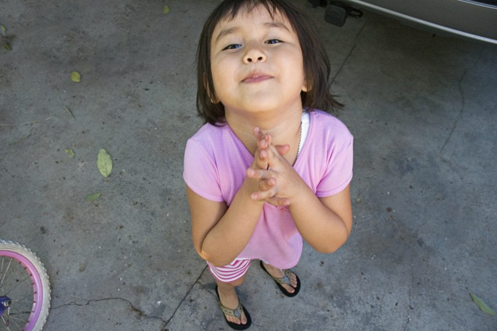 Girl begging. Related words: kid, child, children,  Photo by Aurora Rodriguez via Getty Images