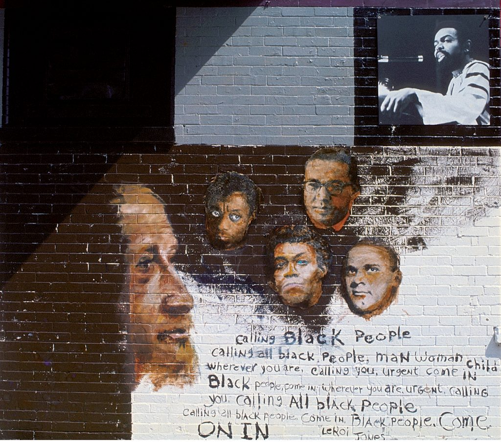 "Detail showing the section of 'The Wall of Respect' celebrating black literary figures, Chicago, IL, 1967. It shows the following figures (left to right): W.E.B. Dubois, James Baldwin, Lerone Bennett, LeRoi Jones, Gwendolyn Brooks, and John Killen. The mural was on 43rd and Langley in Chicago's South Side and was conceived by OBAC (The Organization of Black American Culture). It depicts images of ""Black Heroes"" as positive role models for identity, community formation, and revolutionary action. (Photo by Robert Abbott Sengstacke/Getty Images)"