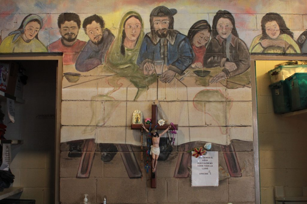 "The ""Last Supper"" mural painted on one of the walls of the kitchen. Photo by Joshua Barajas/PBS NewsHour"