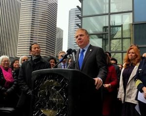 Mayor Ed Murray spoke at a press event regarding threats against sanctuary cities earlier this year. Credit: David Kroman Days after Attorney General Jeff Sessions threatened to withhold grant money from so-called sanctuary cities, Seattle is hitting back: Mayor Ed Murray and City Attorney Pete Holmes will announce a lawsuit at 2 p.m. today challenging the Trump administration's threats against cities that refuse to aid in federal immigration crackdowns. Trump has long threatened to punish cities that don't help federal immigration agents track down or detain undocumented immigrants. If successful, this lawsuit could render that punishment illegal.
