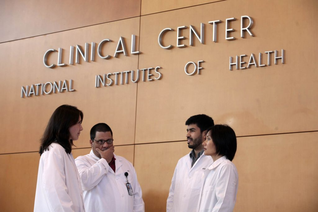 Patricia Burgos, Carlos Gonzalez, Jorge Contreras and Frances Calderon (left-right) stand in the lobby of the National Ins...