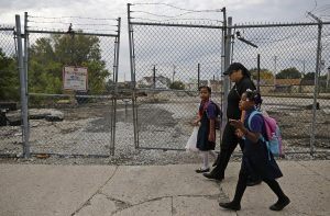 Delores Leonard walks her daughters Emmarie and Erin to school before heading to work at a McDonald's Restaurant in Chicago, on Sept. 25, 2014. Leonard, a single mother raising two daughters, has been working at McDonald's for seven years and has never made more than minimum wage. Photo by Jim Young/Reuters