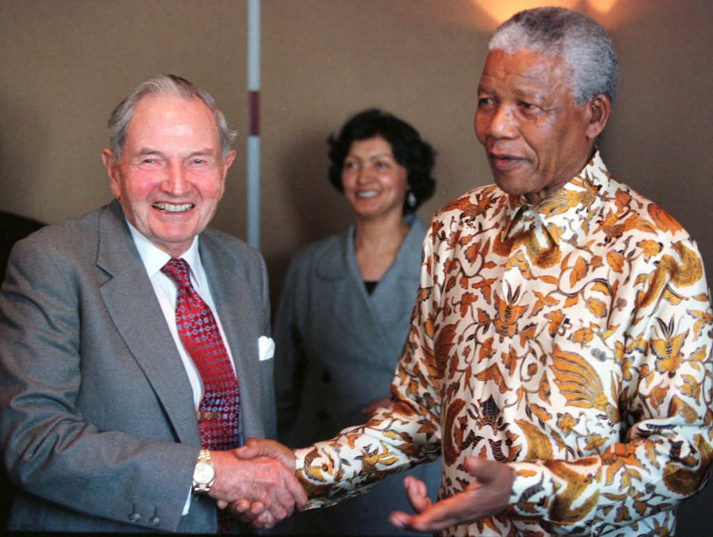 South African President Nelson Mandela poses for photographers with David Rockefeller following a business breakfast held at the Rockefeller Center. Photo by Reuters.