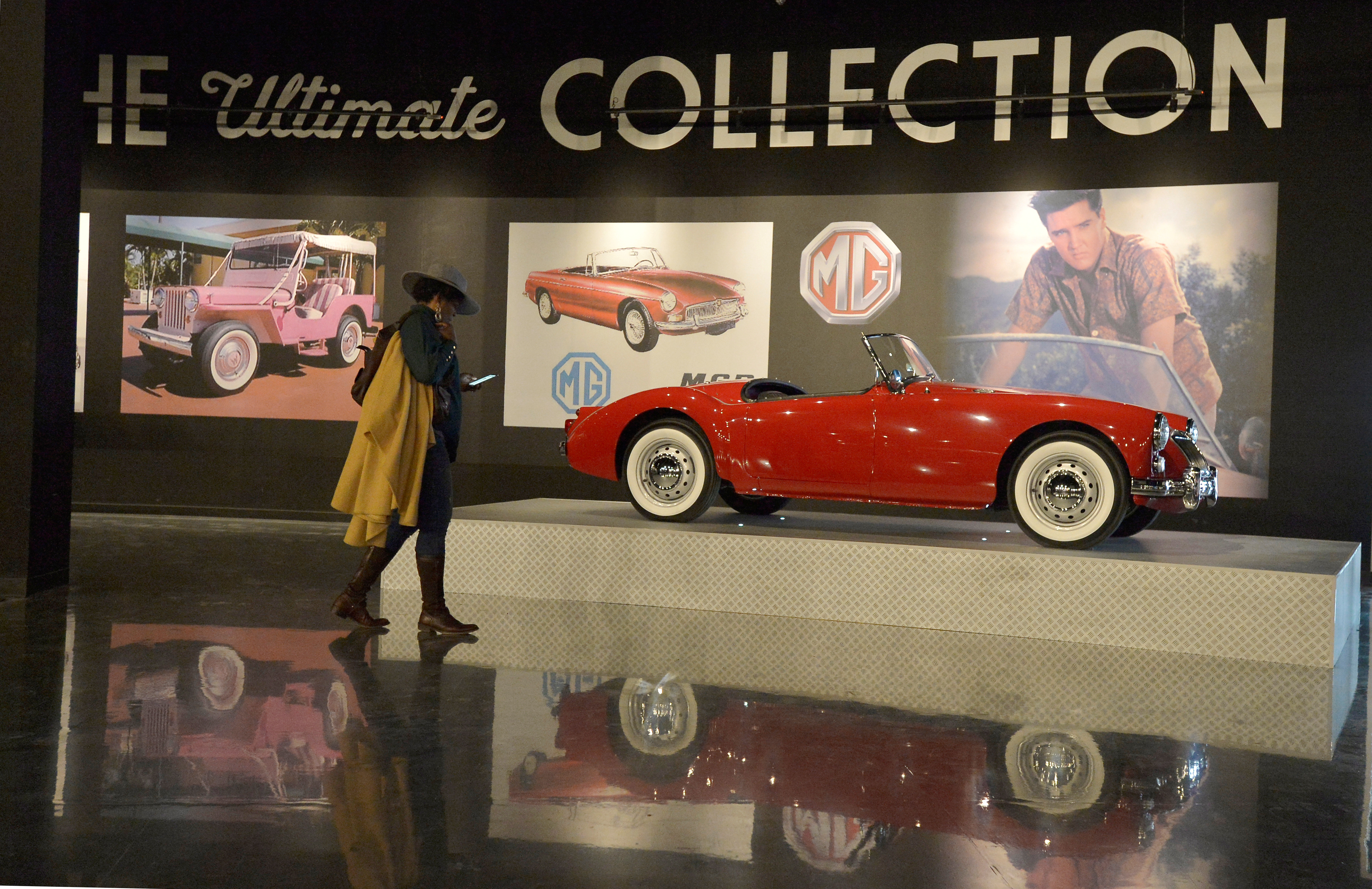 A woman walks past an MG convertible inside the Presley Motors Automobile Museum at the new complex. Photo by Brandon Dill/Reuters