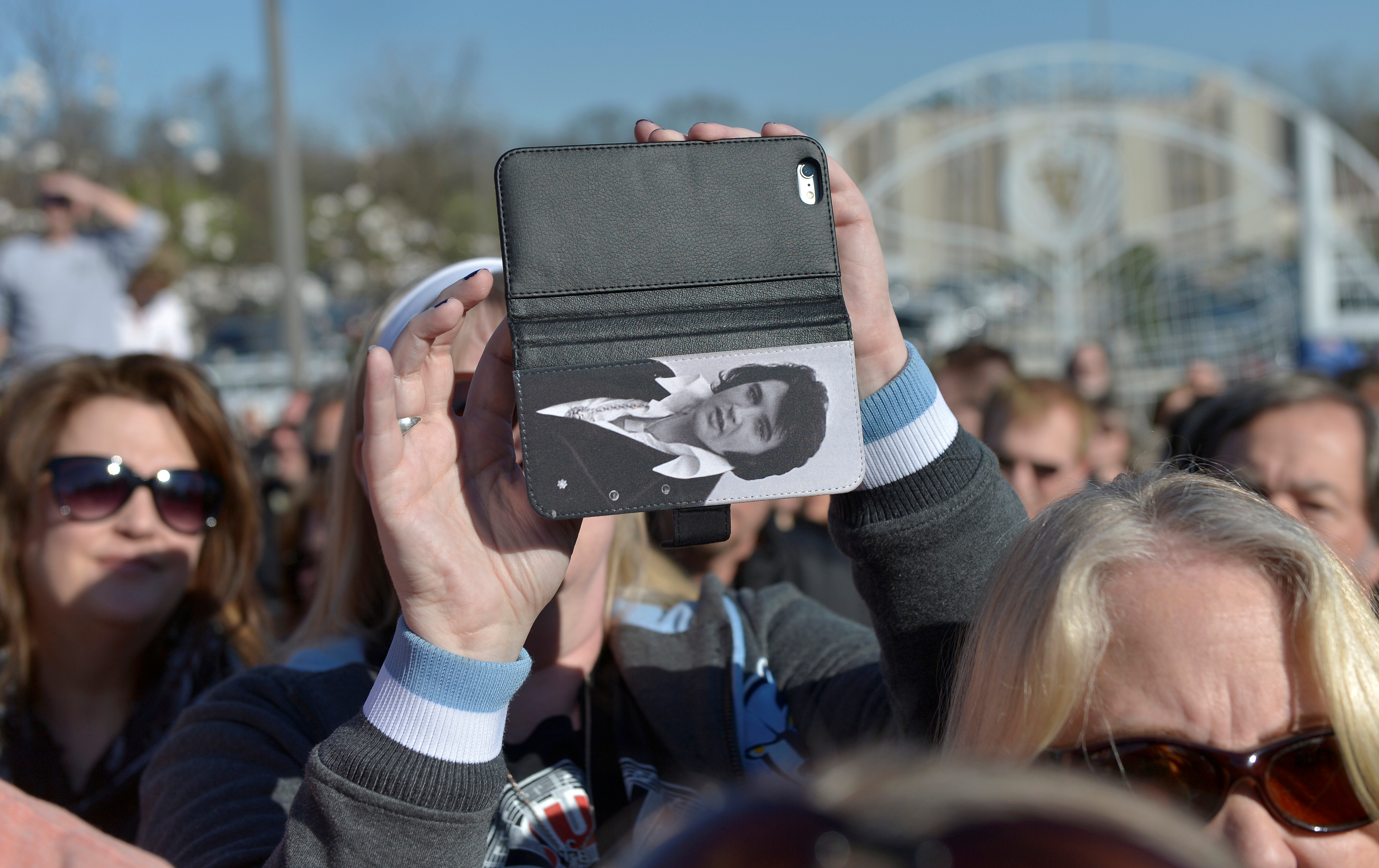 A woman takes a photo with her cell phone before entering the complex on March 2. Photo by Brandon Dill/Reuters