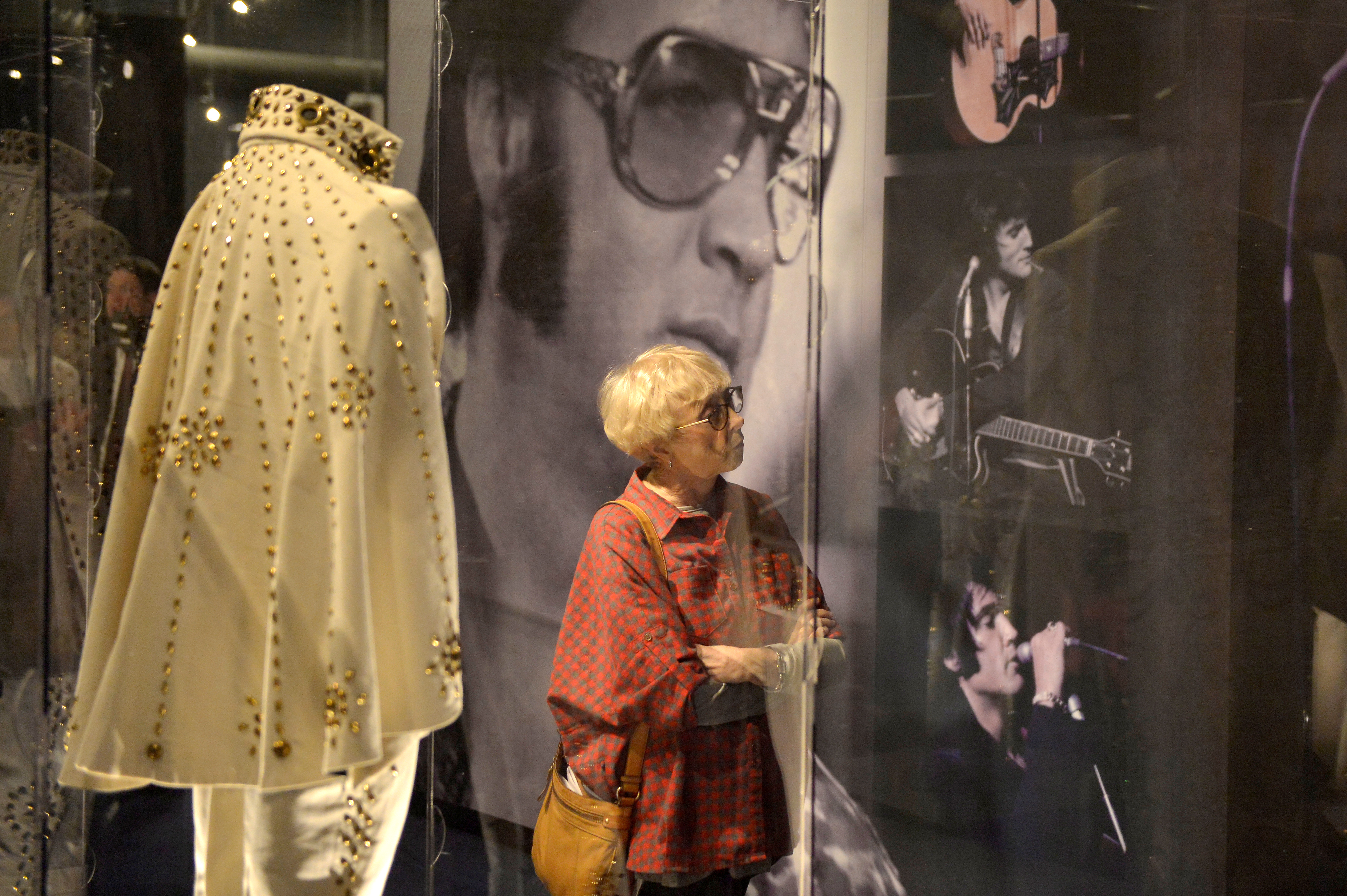 Betty Miller looks at an exhibit of Elvis Presley paraphernalia. Photo by Brandon Dill/Reuters