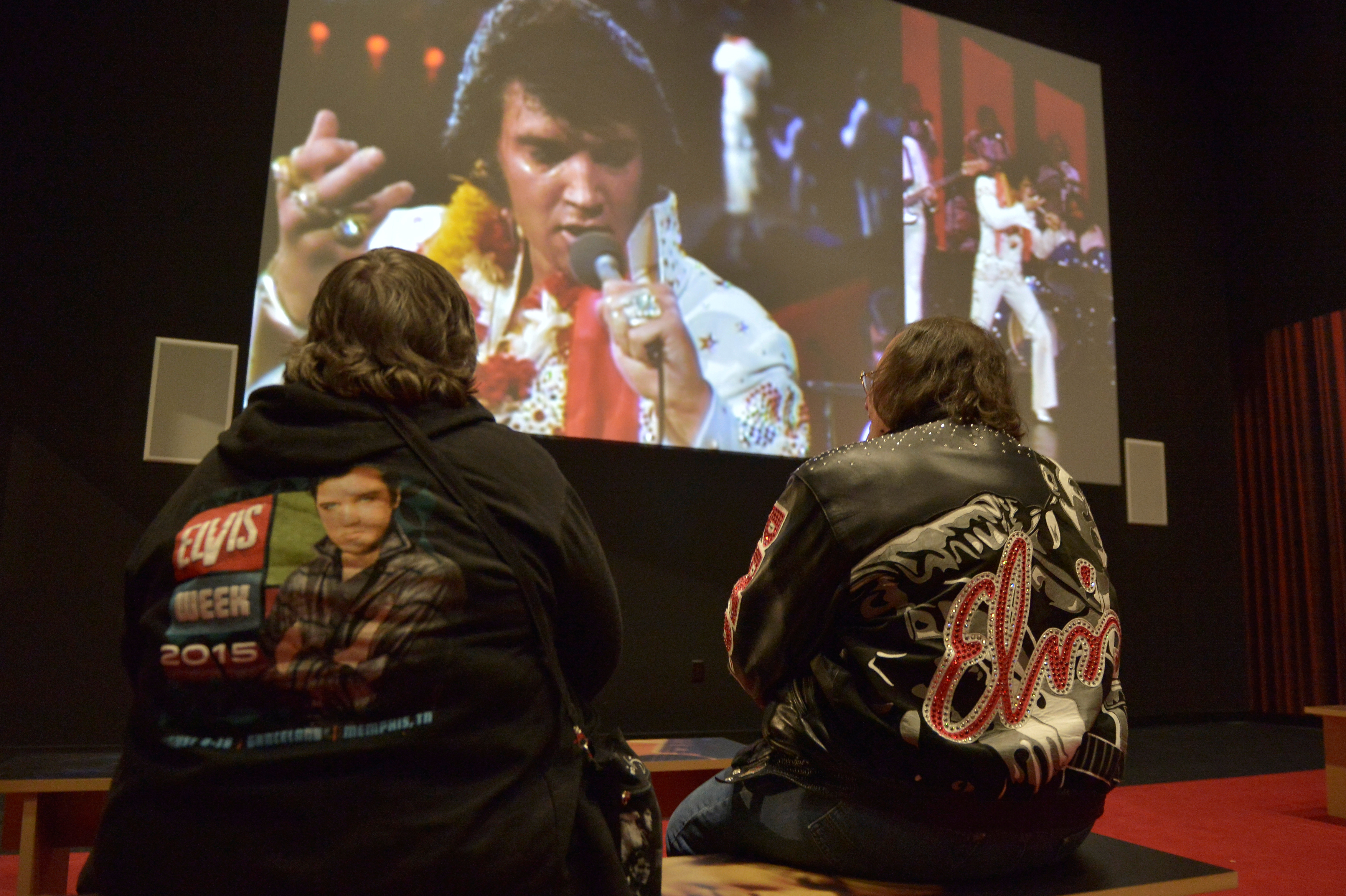 Ann McClain (left) and Neil Spencer of Knoxville, Tennessee watch a video of Elvis Presley performing. Photo by Brandon Dill/Reuters