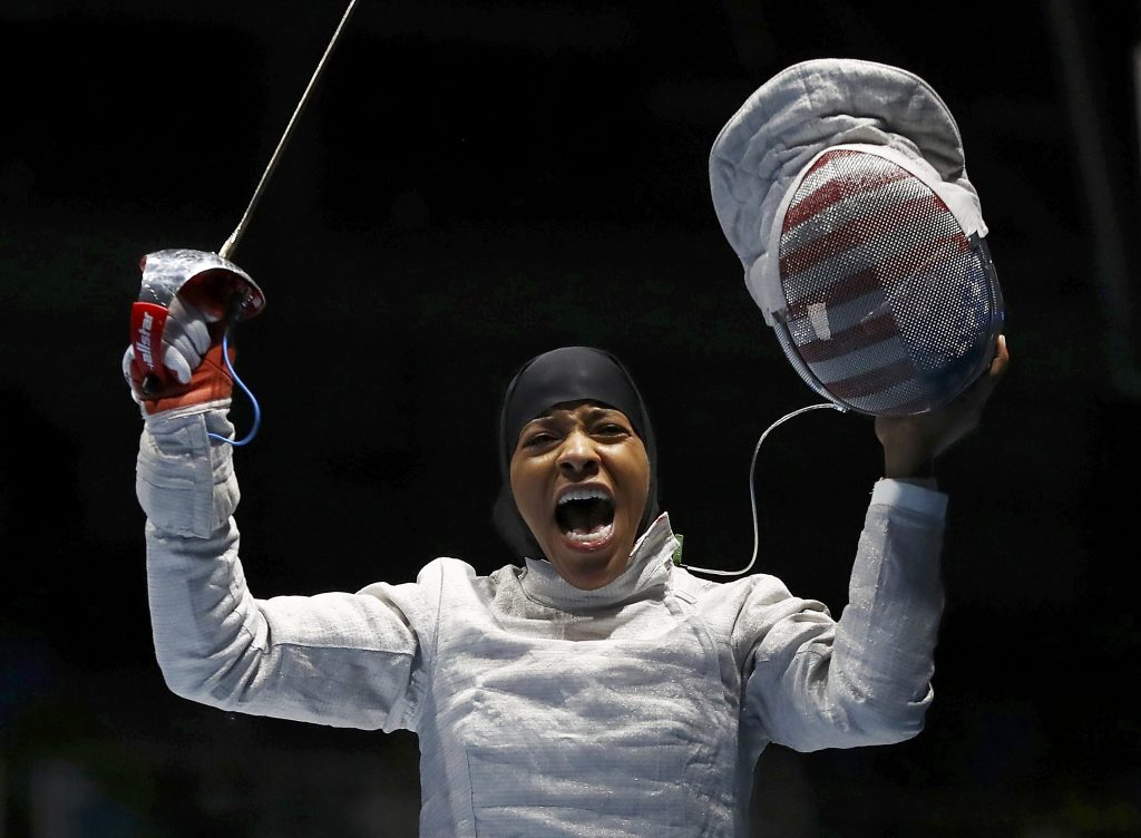 Ibtihaj Muhammad (USA) of USA celebrates winning her match.