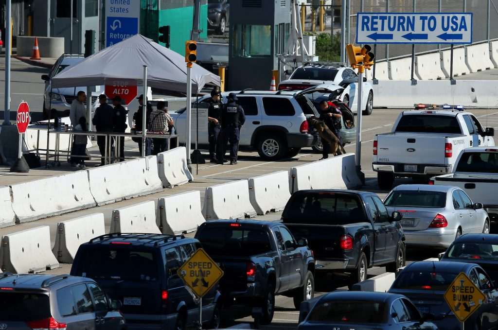 Customs and Border Patrol agents stop traffic heading into Mexico to check vehicles leaving the country in San Ysidro, California. Photo by Mike Blake/Reuters