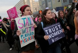 Pro-choice supporters of a Planned Parenthood rally outside a Planned Parenthood clinic in Detroit, Michigan, Photo by Rebecca Cook/Reuters