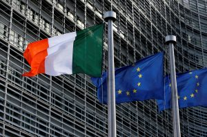 Irish and EU flags are pictured outside the EU Commission headquarters in Brussels