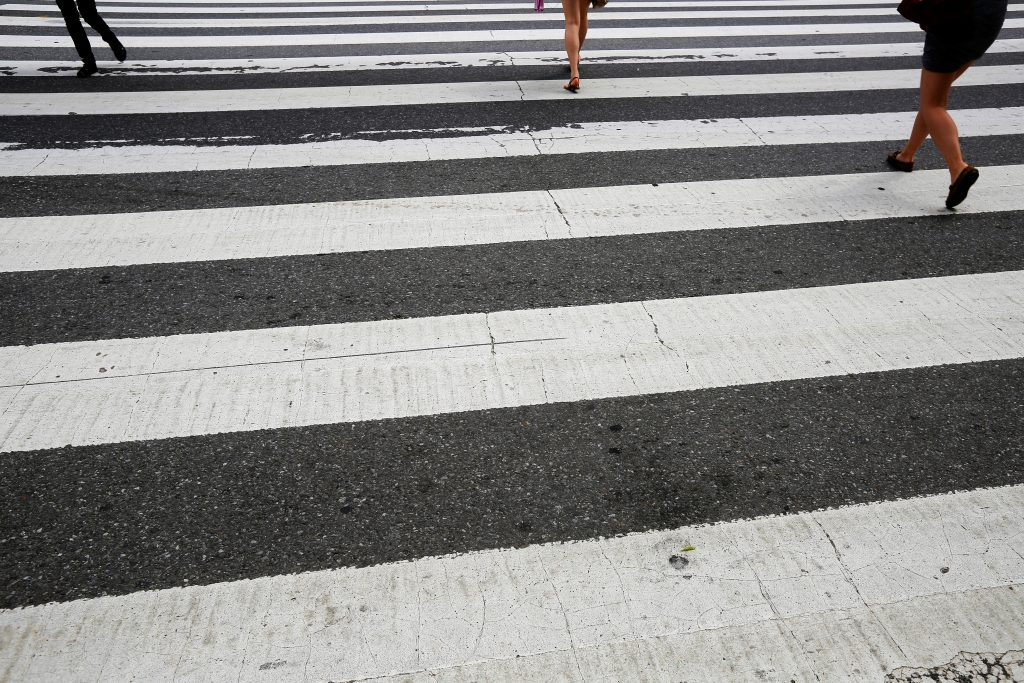 Pedestrians walk over a crosswalk in Cambridge, Massachusetts. Photo by Brian Snyder/Reuters