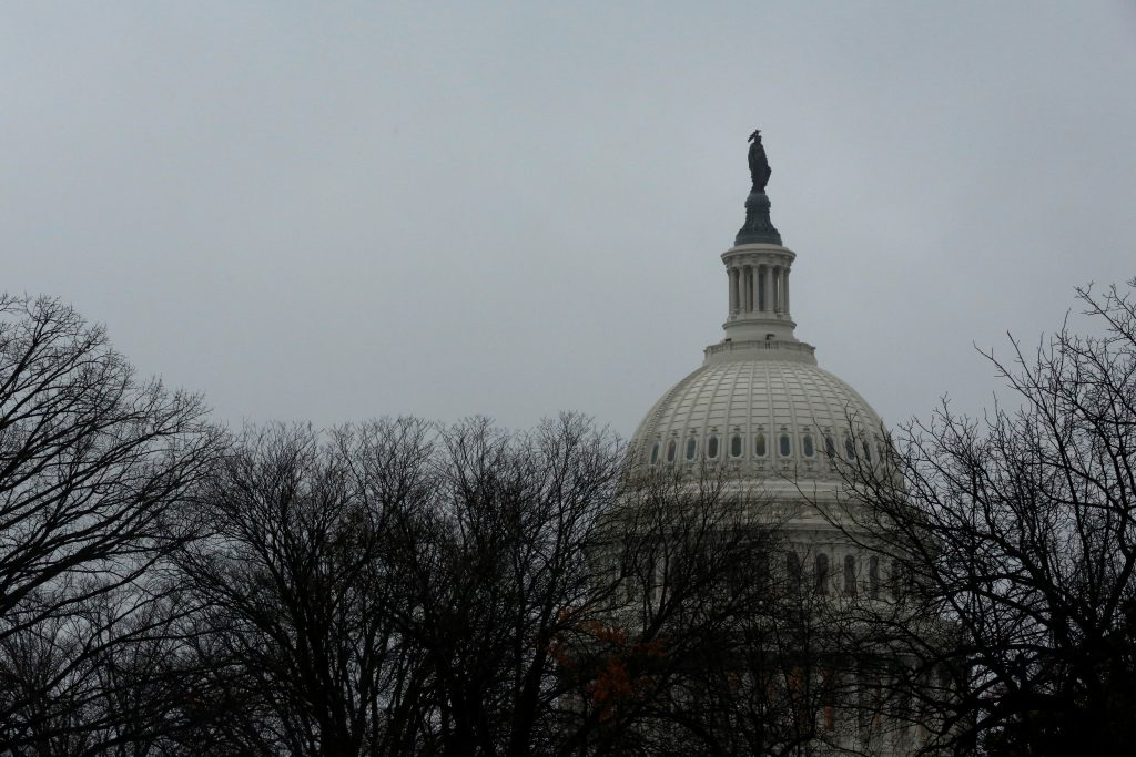 A rainy, gray sky tops the U.S. Capitol dome on the first day of the new session of Congress in Washington, U.S. January 3, 2017. REUTERS/Jonathan Ernst