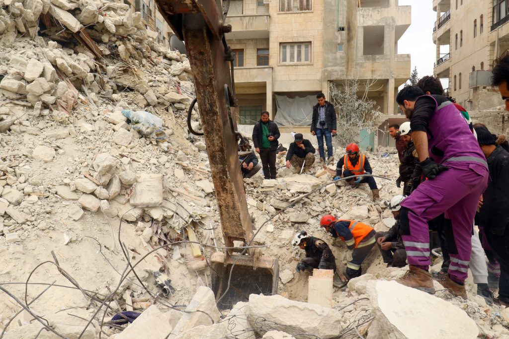 Rescue workers remove rubble in a damaged site after an airstrike on Idlib, Syria on March 15. Photo by Ammar Abdullah/Reuters