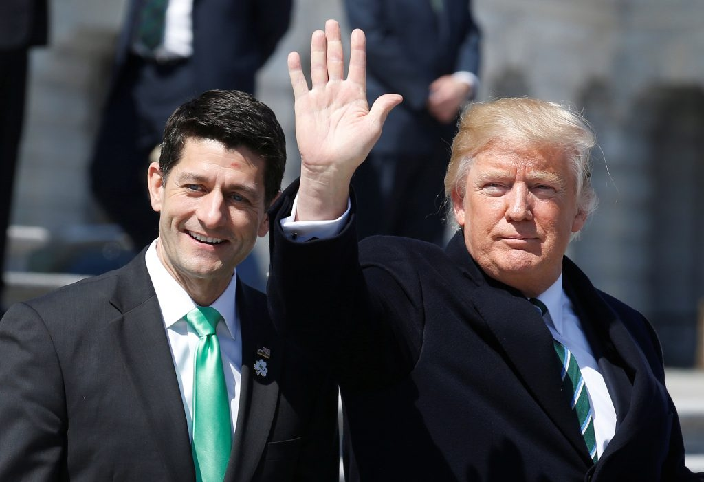 U.S. President Donald Trump waves with Speaker of the House Paul Ryan (R-WI) after attending a Friends of Ireland reception on Capitol Hill in Washington, U.S., March 16, 2017. REUTERS/Joshua Roberts - RTX31CTS