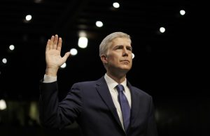 U.S. Supreme Court nominee judge Neil Gorsuch is sworn in to testify at his Senate Judiciary Committee confirmation hearing on Capitol Hill in Washington, U.S., March 20, 2017. REUTERS/James Lawler Duggan - RTX31WLO