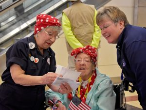 "The Army Engineer Spouses Club welcome a group of more than 30 Michigan-based ""Rosie the Riveters"" at Ronald Reagan International Airport in Arlington, Virginia, U.S., March 22, 2016. Photo by Cynthia Mitchell/U.S. Army Corps of Engineers, Baltimore District/Handout via Reuters"