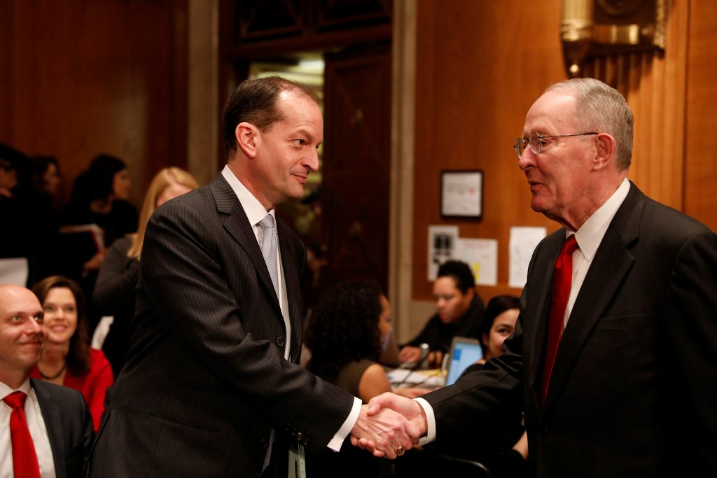 Alex Acosta, President Donald Trump's nominee to be Secretary of Labor, greets Sen. Lamar Alexander (R-TN) as he arrives for his confirmation hearing before the Senate Health, Education, Labor, and Pensions Committee on Capitol Hill in Washington, D.C., U.S. March 22, 2017. REUTERS/Aaron P. Bernstein - RTX326VM