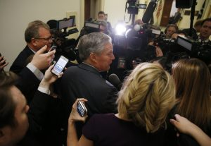 House Freedom Caucus Chairman Rep. Mark Meadows (R-NC) is surrounded by reporters and television cameras as he arrives at a caucus meeting after a trip to the White House to meet with President Donald Trump about the AHCA health care bill in Washington, U.S., March 23, 2017. REUTERS/Jonathan Ernst - RTX32FNI
