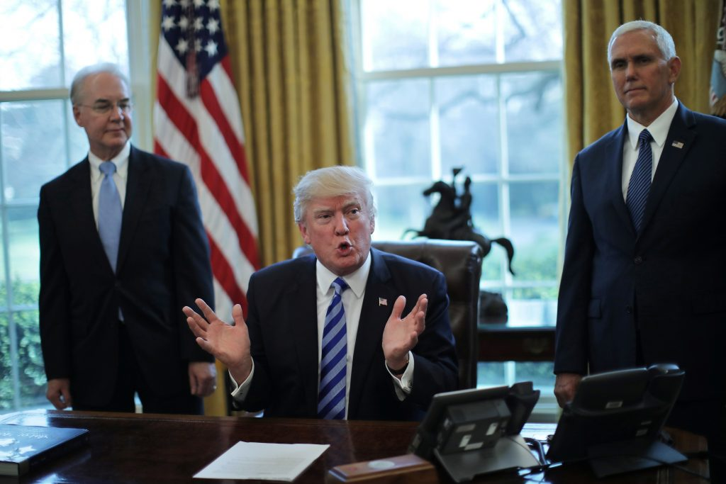 U.S. President Donald Trump talks to journalist at the Oval Office of the White House after the AHCA health care bill was pulled before a vote,  Photo by REUTERS/Carlos Barria.