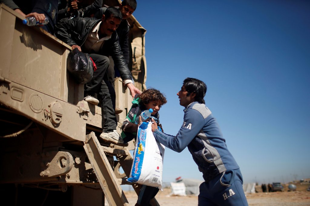 Displaced Iraqis flee their homes as Iraqi forces battle with Islamic State militants, in western Mosul