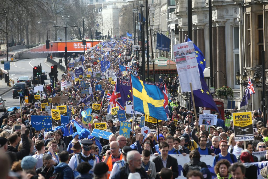 Demonstrators take part in a Unite for Europe march, as they head towards Parliament Square, in central London