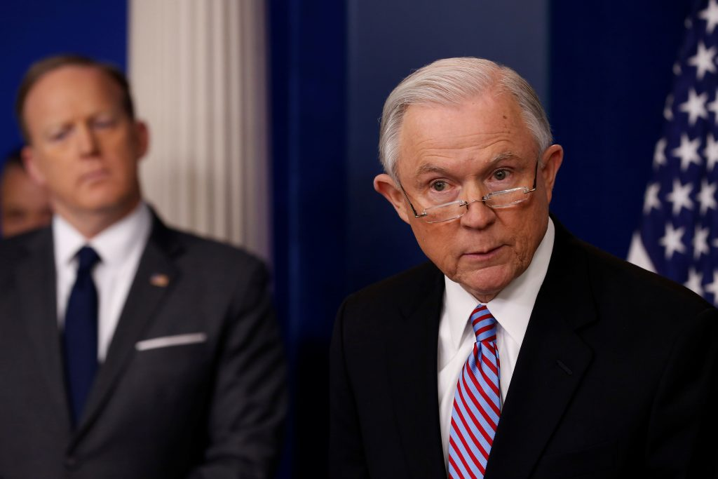 U.S. Attorney General Jeff Sessions (R) joins White House Press Secretary Sean Spicer (L) for the daily press briefing at ...