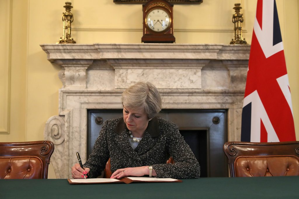 British Prime Minister Theresa May in the cabinet office signs the official letter to European Council President Donald Tusk invoking Article 50 and the United Kingdom's intention to leave the EU on March 28 in London. Photo by Christopher Furlong/Pool via Reuters