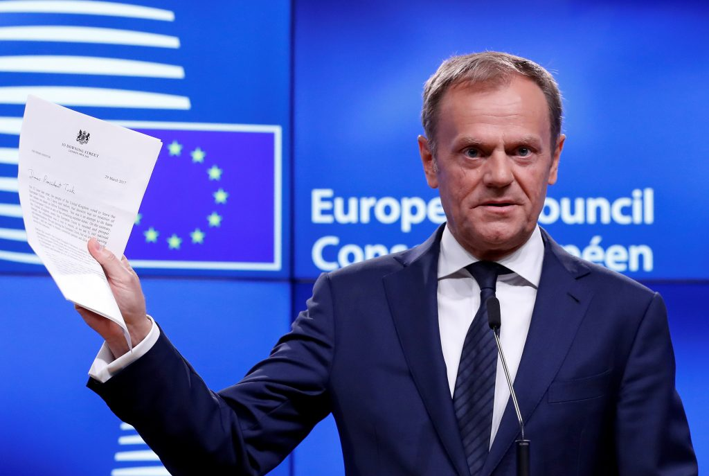 European Council President Donald Tusk holds up British Prime Minister Theresa May's Brexit letter in Brussels on March 29. Photo by Yves Herman/Reuters