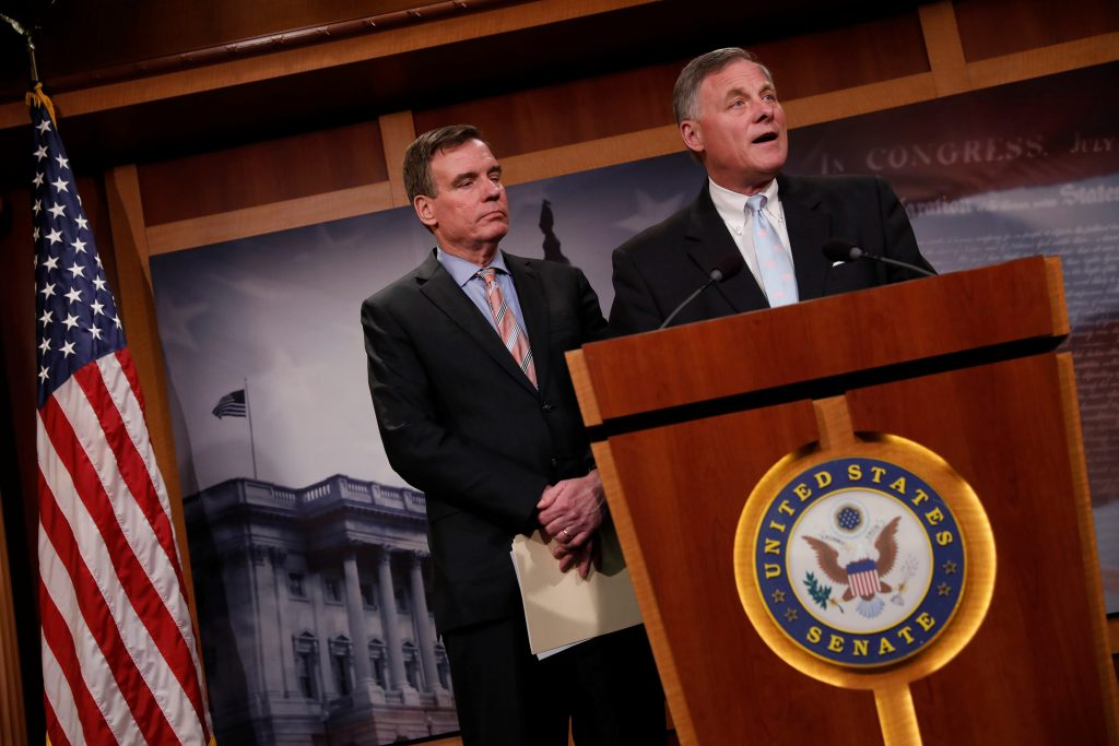 Senate Intelligence Committee Chairman Sen. Richard Burr (R-NC), accompanied by Senator Mark Warner (D-VA), vice chairman of the committee, speaks at a news conference to discuss their probe of Russian interference in the 2016 election on Capitol Hill in Washington, D.C. REUTERS/Aaron P. Bernstein.