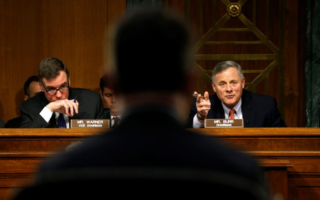 "Senate Intelligence Committee Chairman Sen. Richard Burr, R, (R-NC) and ranking Democrat Sen. Mark Warner, L, (D-VA) hold a committee hearing titled ""Disinformation: A Primer in Russian Active Measures and Influence Campaigns"" at the U.S. Capitol in Washington, U.S., March 30, 2017. REUTERS/Kevin Lamarque TPX IMAGES OF THE DAY - RTX33E50"