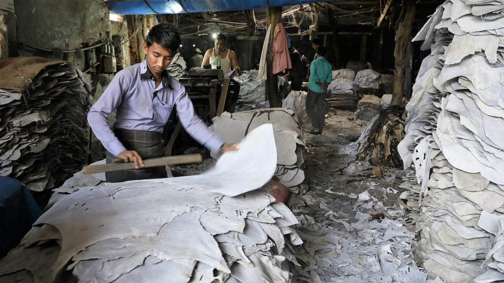Workers process hides at a tannery in Dhaka's Hazaribagh district. Leather in Bangladesh has grown to a $1 billion per year industry. Screen shot by Justin Kenny