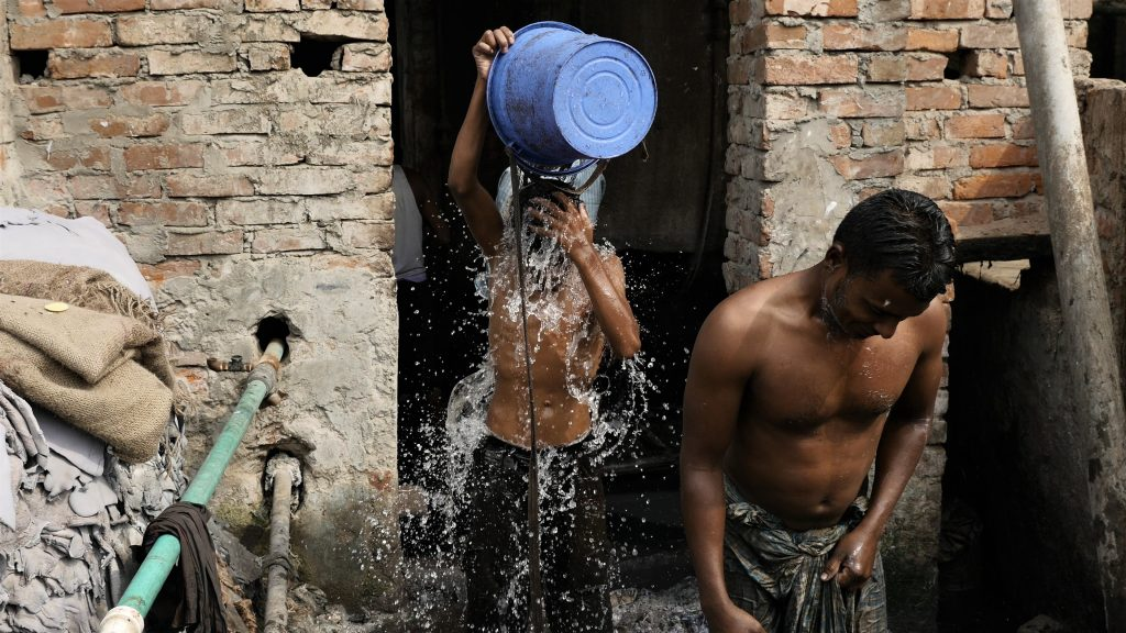 Workers rinse off after their jobs at a tannery. Screen shot by Justin Kenny