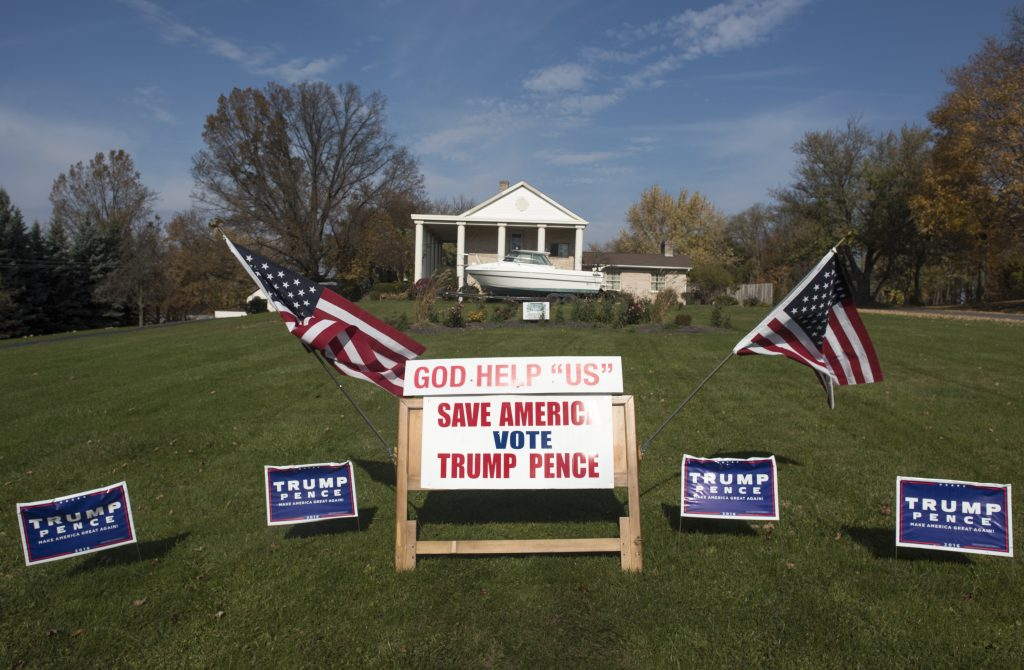 Campaign signs, supporting Donald Trump and Mike Pence, are displayed on November 8, 2016 in Salem, Ohio. Photo by Ty Wright/Getty Images