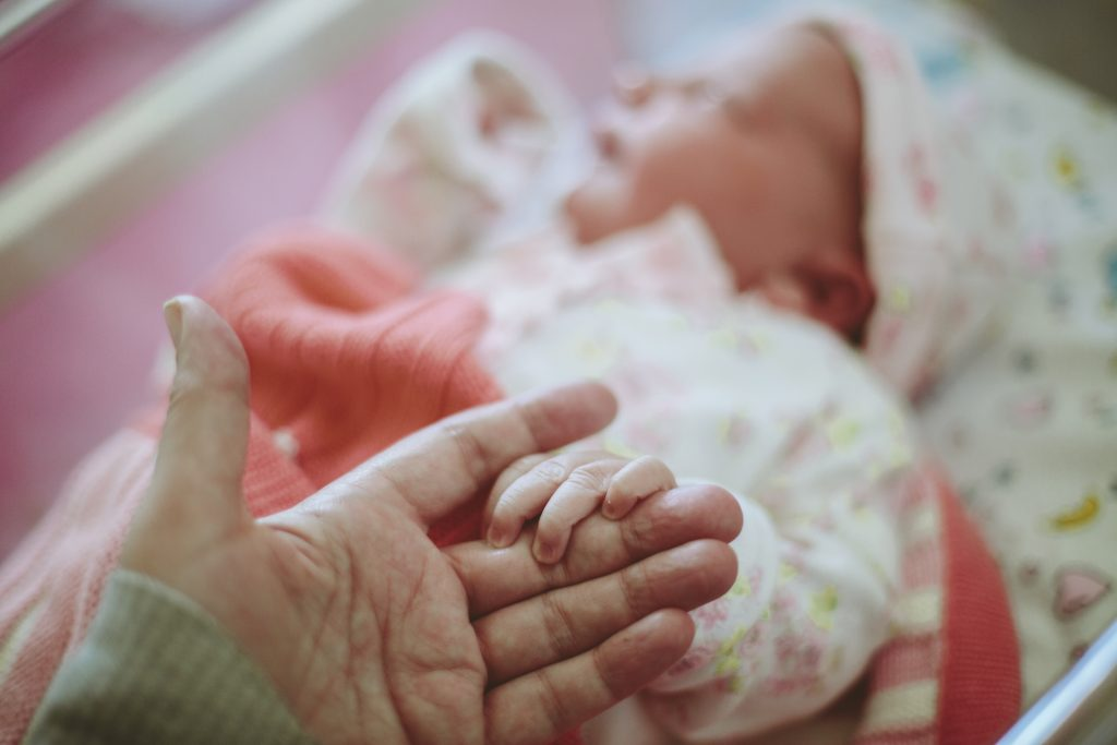 For newborn babies, human touch may be a brain booster. Photo by Sally Anscombe/via Getty Images