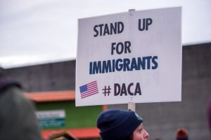 """A protester holds a sign in support of undocumented students at a """"ICE Out of Oregon"""" rally co-organized by Milenio.org and Voz HIspana Cambio Comunitario at the ICE offices in Portland, Oregon. Photo by Diego G Diaz/Icon Sportswire via Getty Images."""